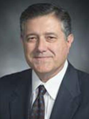 State Representative Richard Peña Raymond